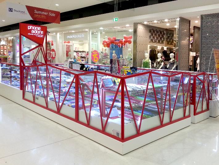 red linear Glass Happytel Phone Kiosk Design