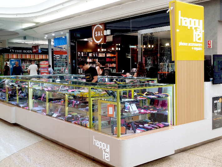 yellow linear phone mana mall kiosk