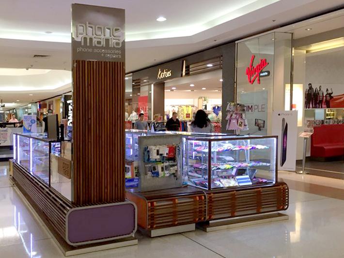 Phone mana mall kiosk in timber base & glass shelf
