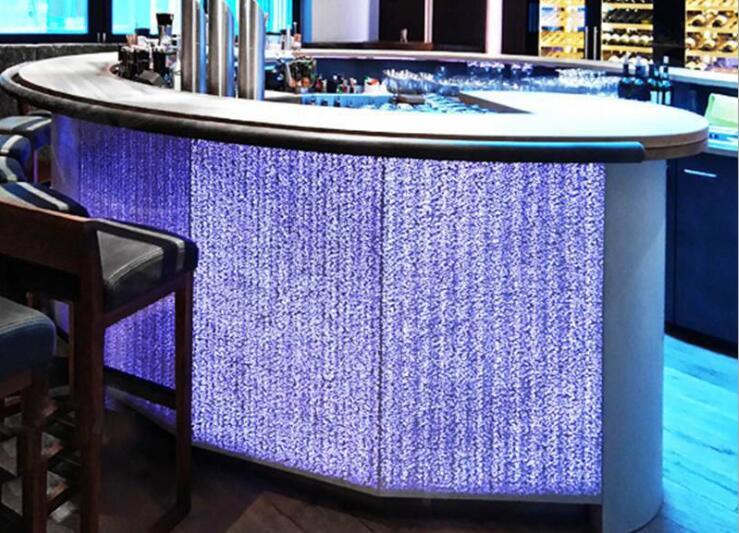 Illuminated concrete made reception bar in sea theme