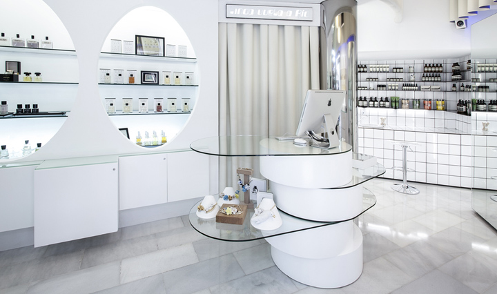 this featured till counter is made by many sections of tempered glass and white PU paint plinth.
