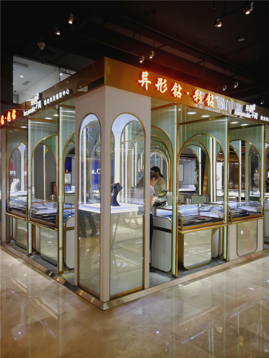white and gold Jewelry mall kiosk with many arched door shapes decoration