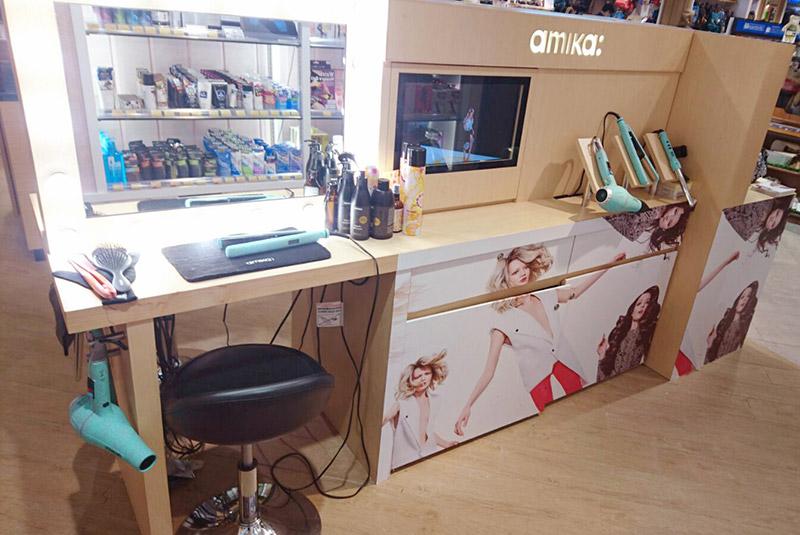 amika hair bar mini kiosk with work demo