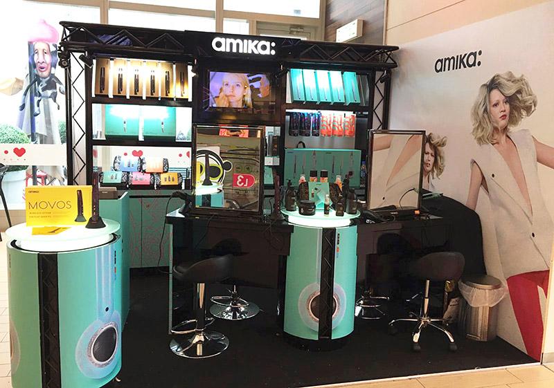 amika hair products display wall bay